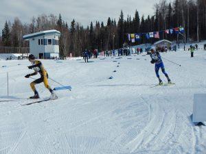 two skiers racing around the corner